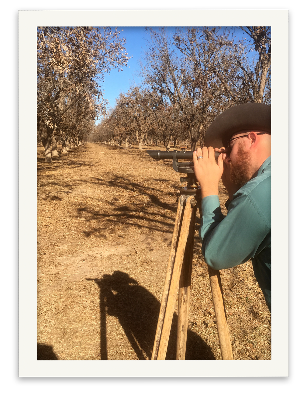 Belding Farms General Manager Zachary Swick checking the land slope before starting to irrigate.